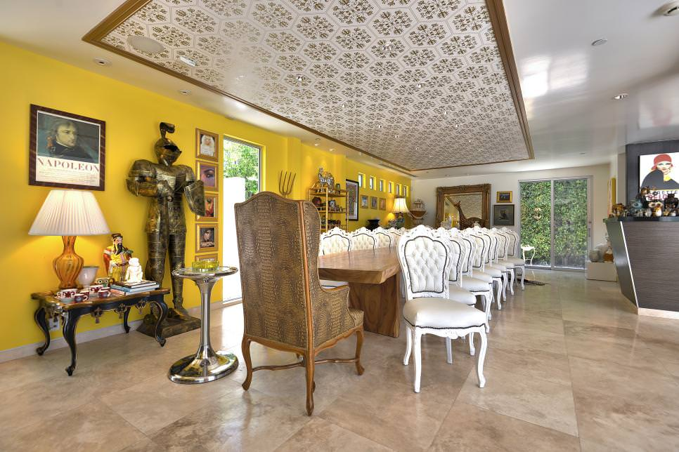 Eclectic dining room with yellow accent wall design for Yellow dining room ideas