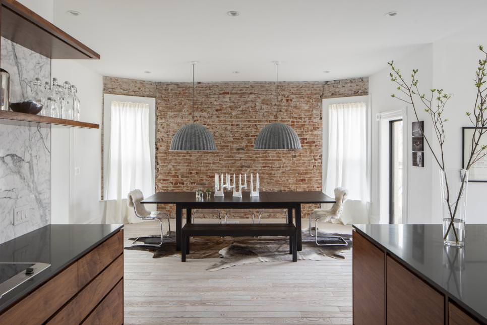 Neutral Contemporary Dining Room With Brick Wall