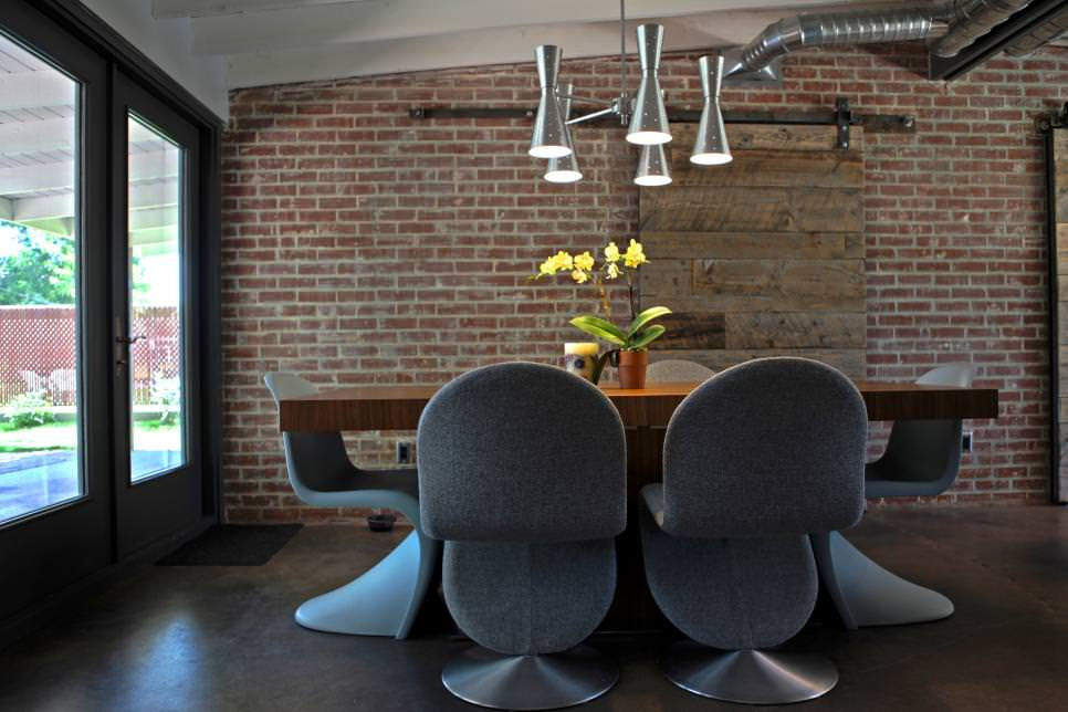Modern Dining Room With Exposed Brick Wall