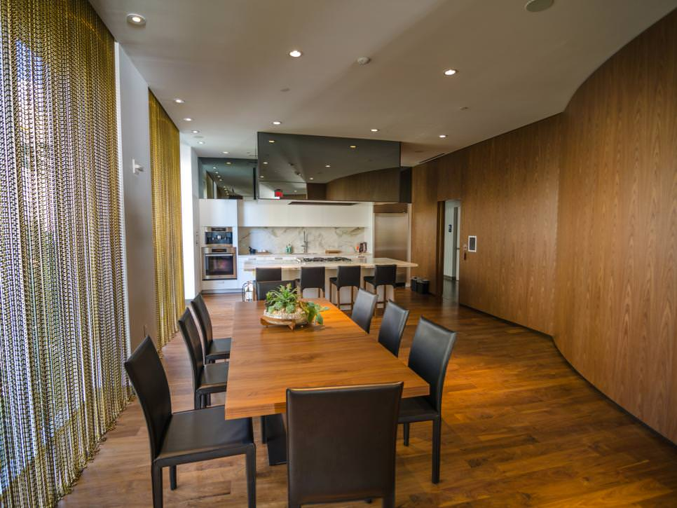 Dining Room With Curved Wood Wall design
