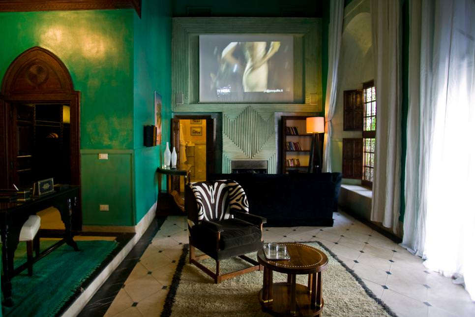 moroccan style living room with jade green walls