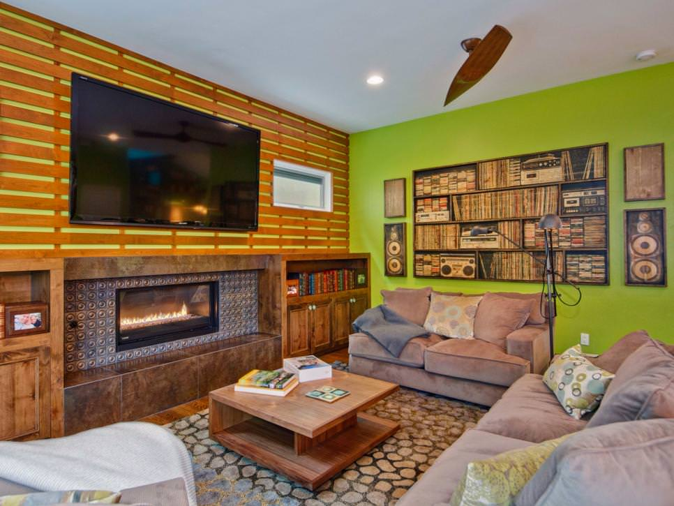 green eclectic living room with accent wall