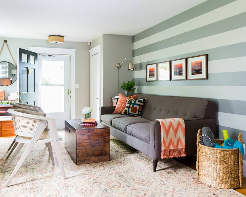 living room with green striped focal wall