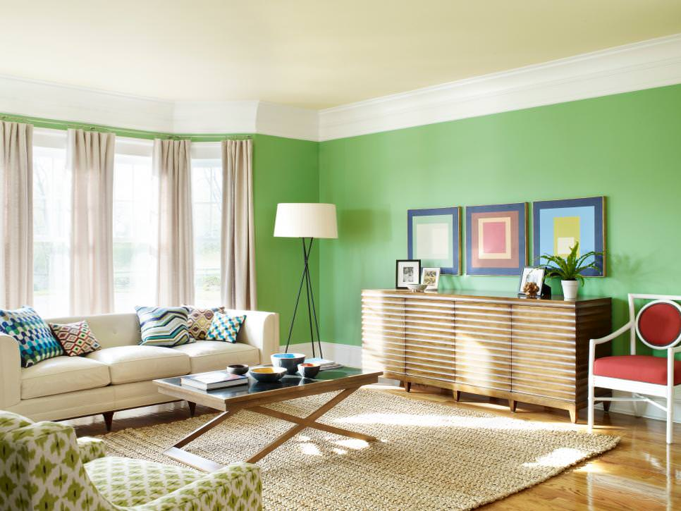 contemporary living room with colorful green walls