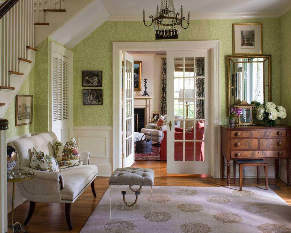 traditional living room with pretty green wallpaper