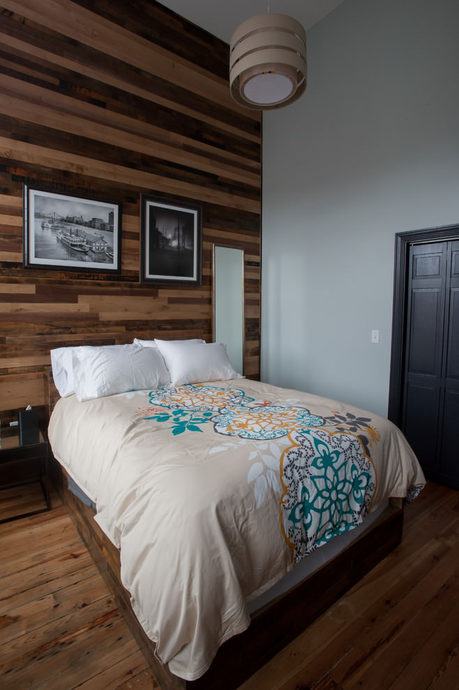 Contemporary bedroom with brown wooden wall design