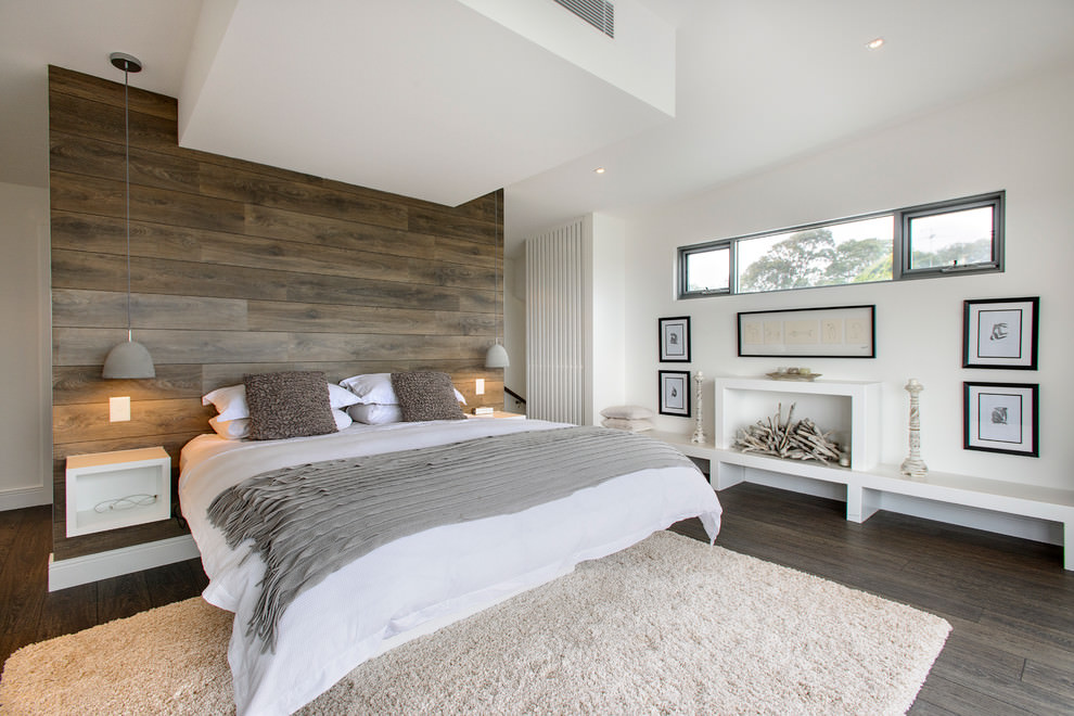 Elgant bedroom with wooden wall design