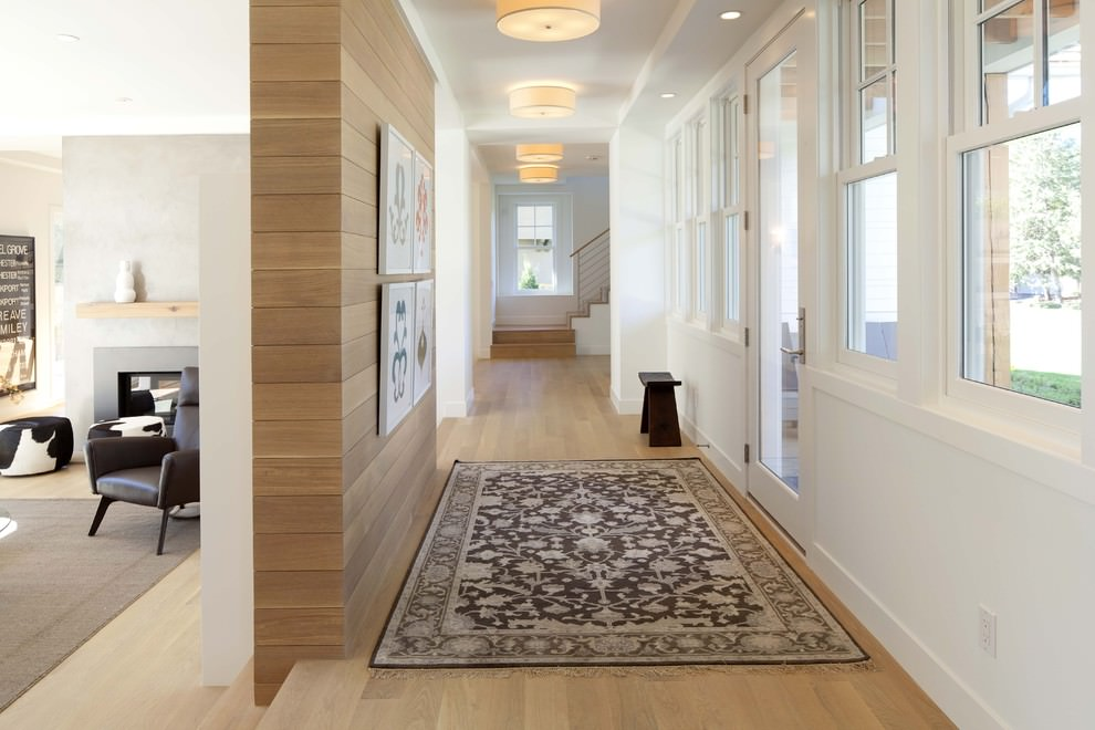 Contemporary Hall with brown wooden wall design