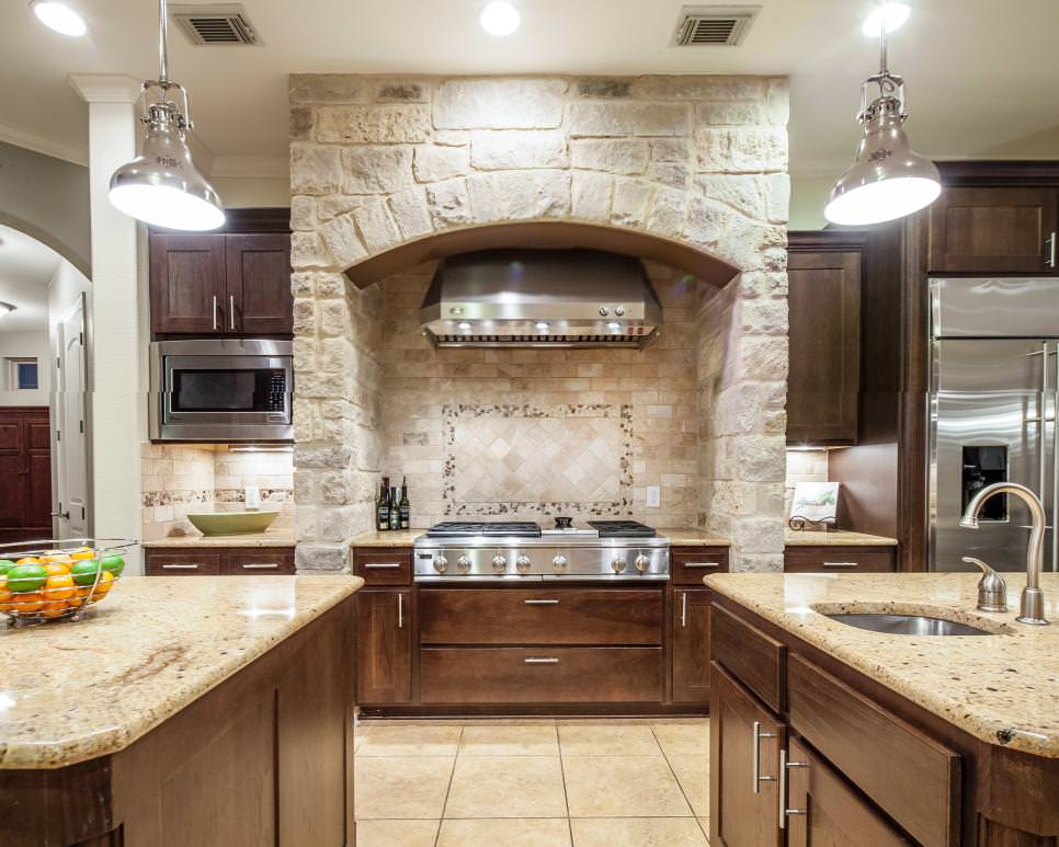 Mediterranean Kitchen With Stone Wall design
