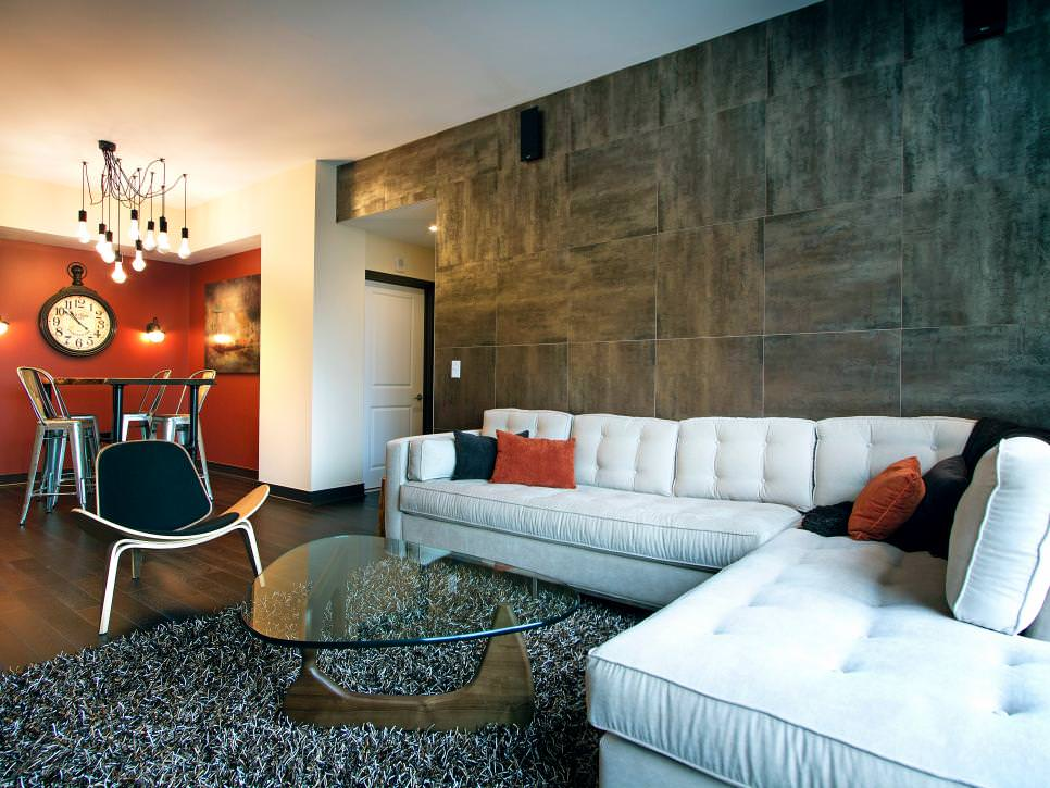 contemporary living room with gray tile wall