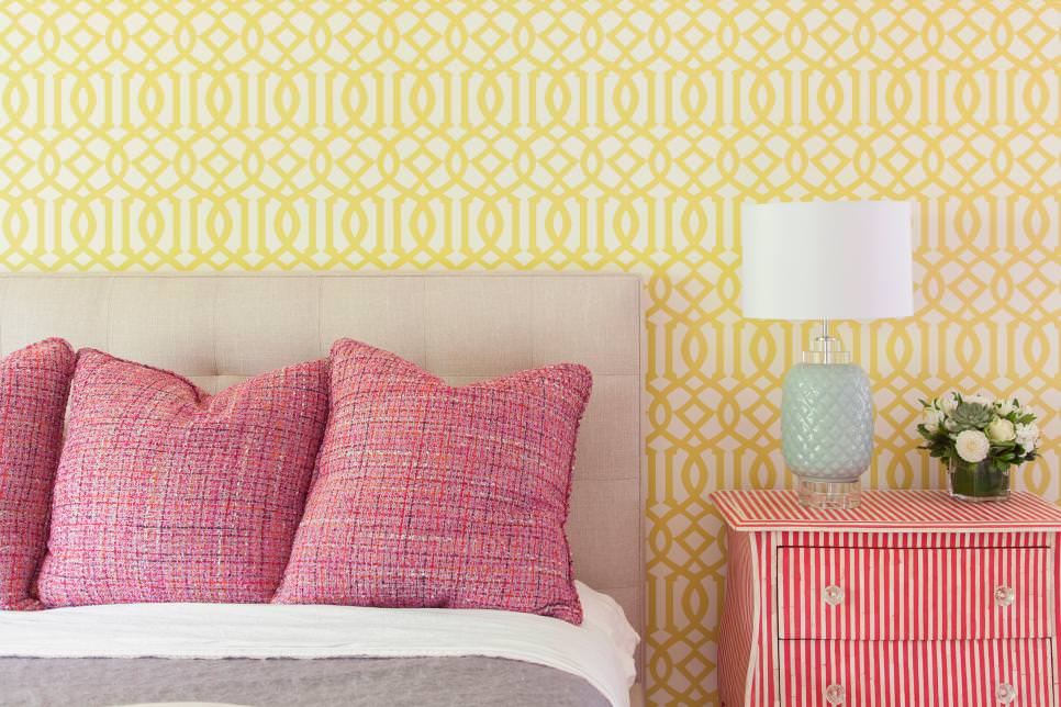 geometric wallpaper in bedroom with bold accent pieces