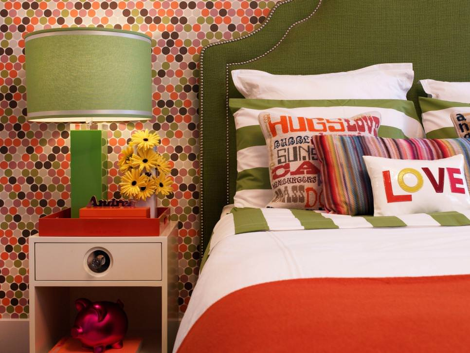multicolored bedroom with geometric wallpaper