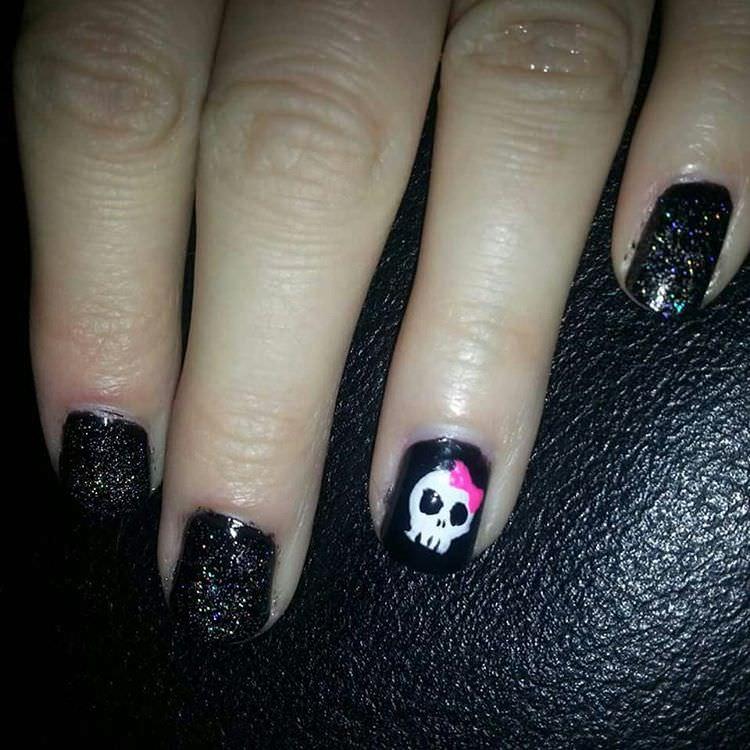 skull black glittering nail design