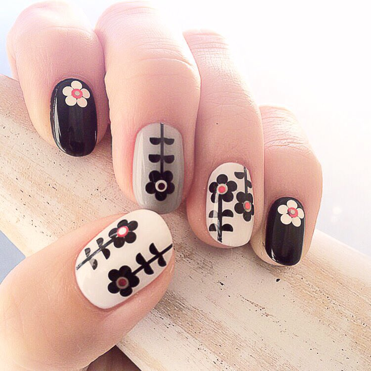Beautiful Flower-White and Black Nail Design