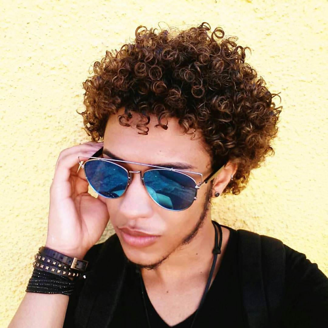 neat curly hairstyle for men