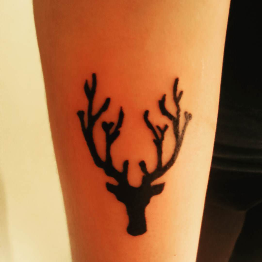 cute black deer tattoo