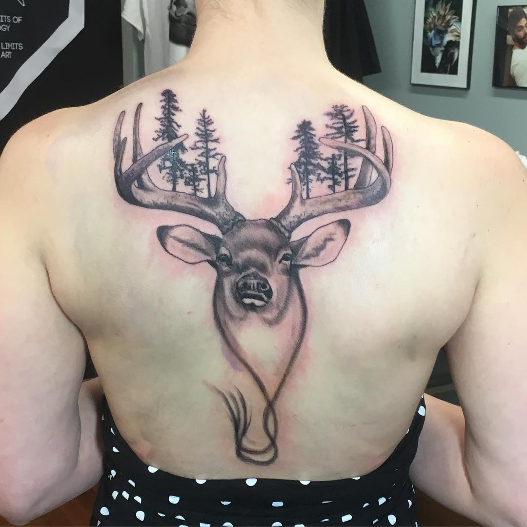 beautiful deer tattoo on back for women