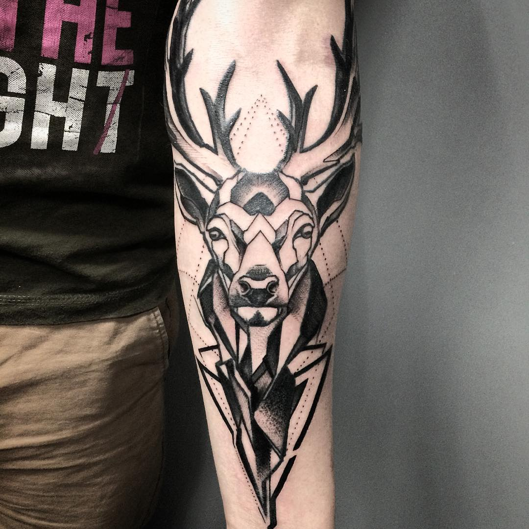 dark black deer tattoo