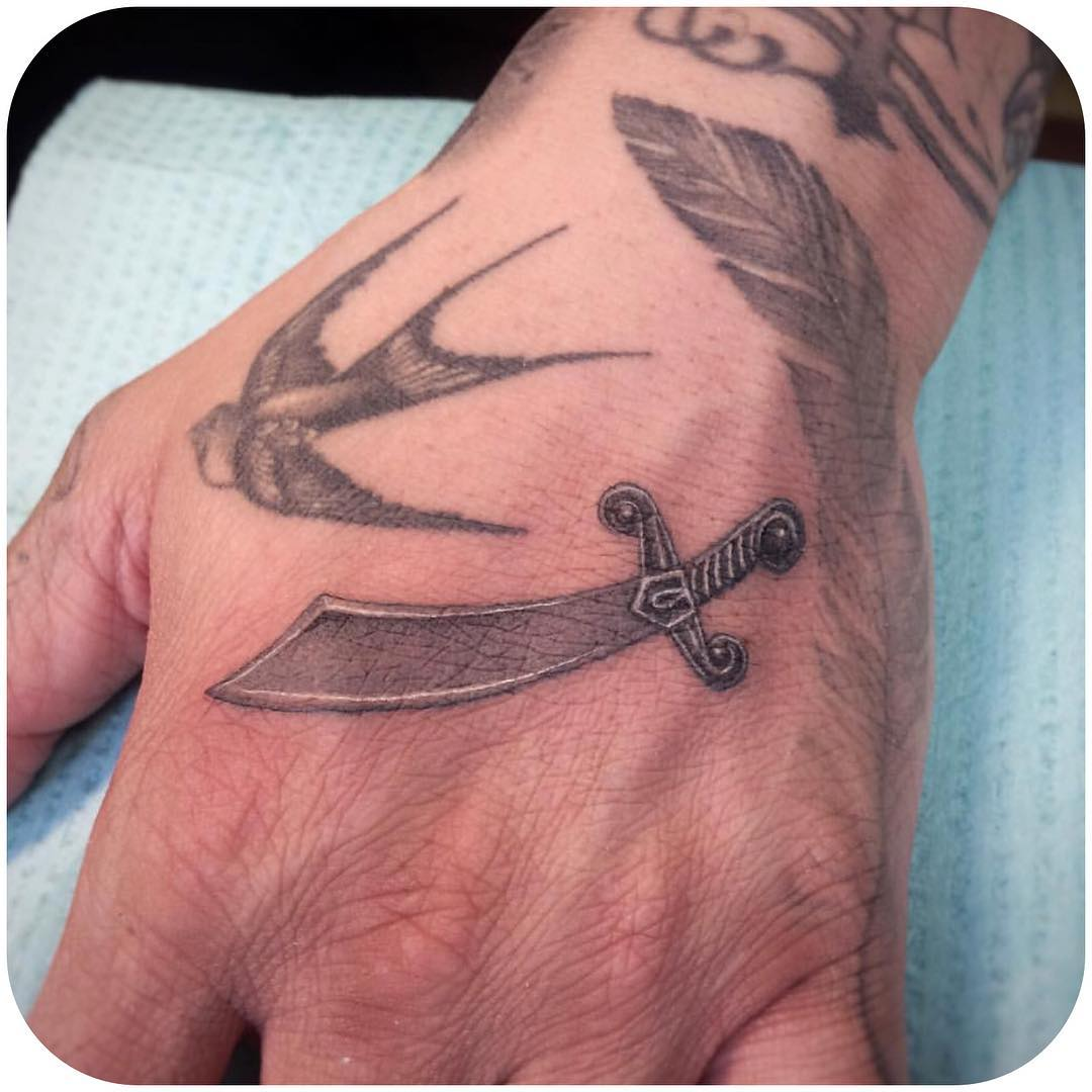 Sword Tattoo on Hand