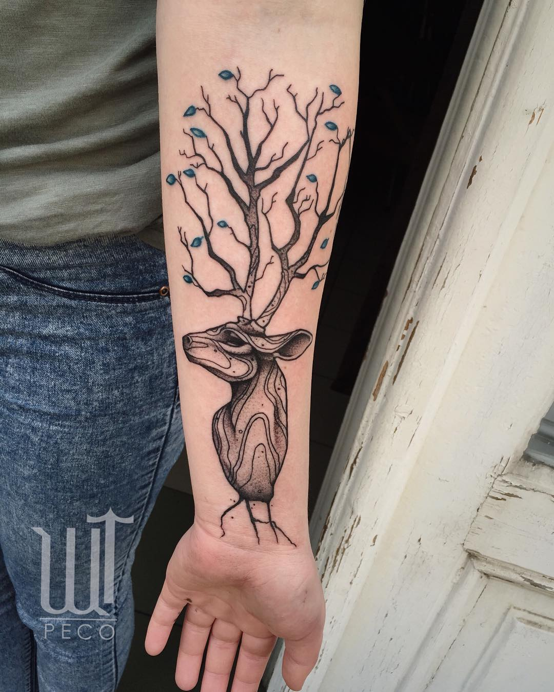 deer tattoo on hand