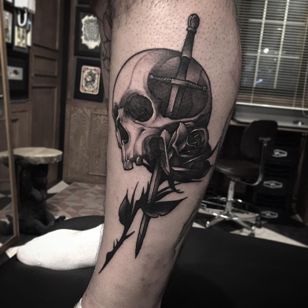 skull sword tattoo design