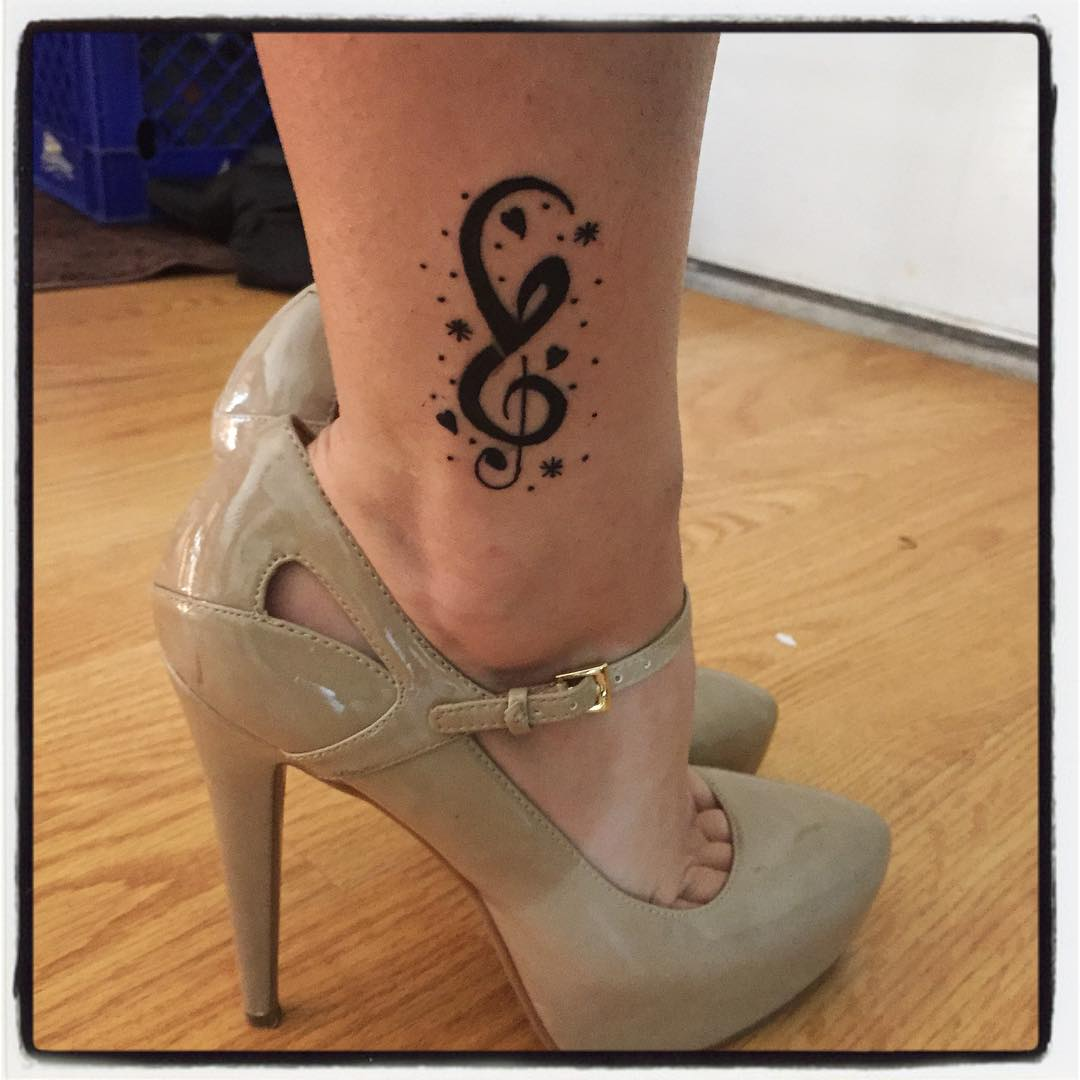 Music Symbol With Stars Tattoo Design