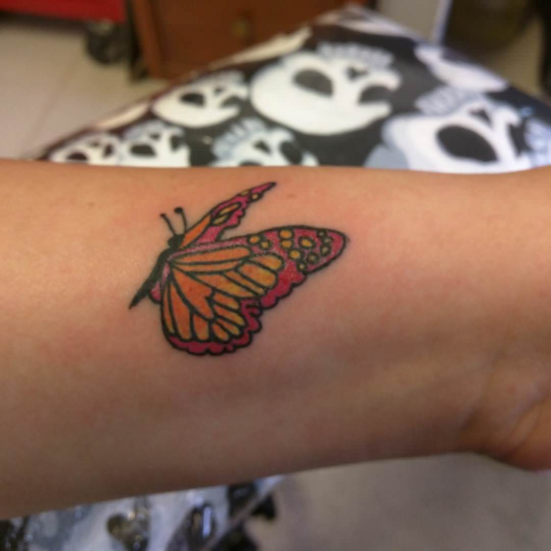 pink yellow butterfly tattoo