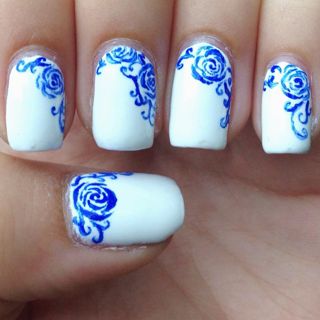 blue rose and white nail design