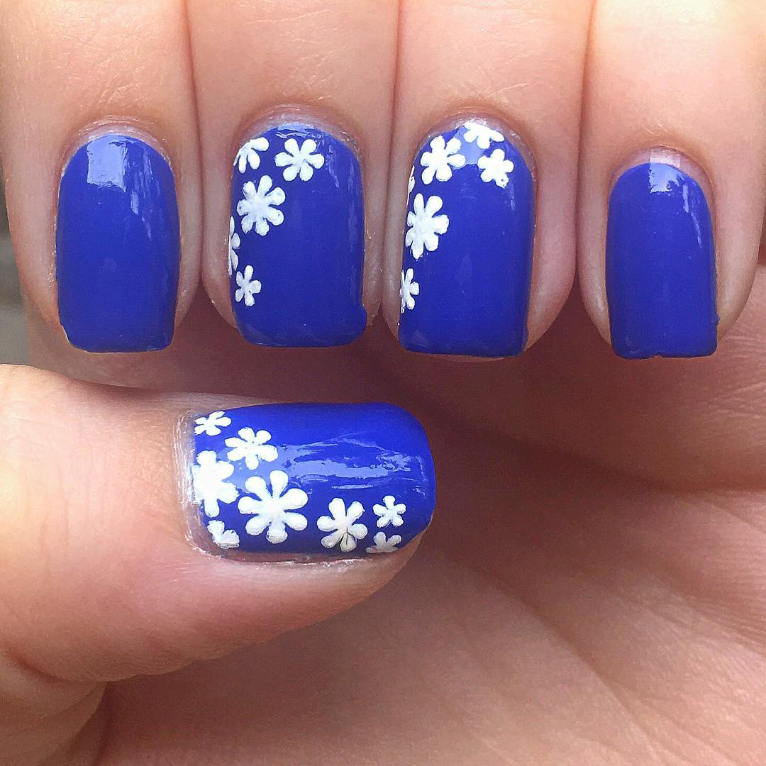 white flowers blue nail design