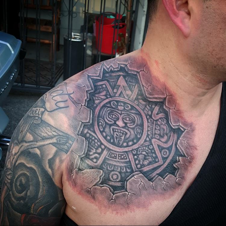 stylish sun aztec tattoo