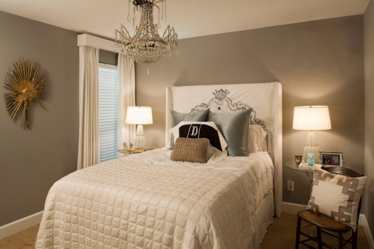 transitional headboard paired with a crystal chandelier