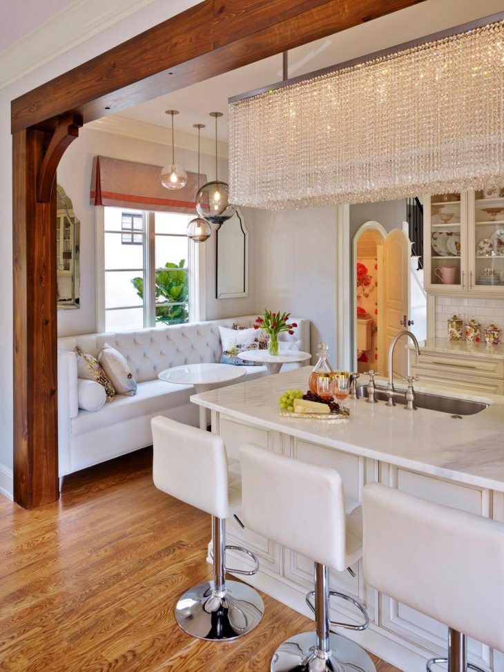Transitional White Kitchen With Dramatic Chandelier