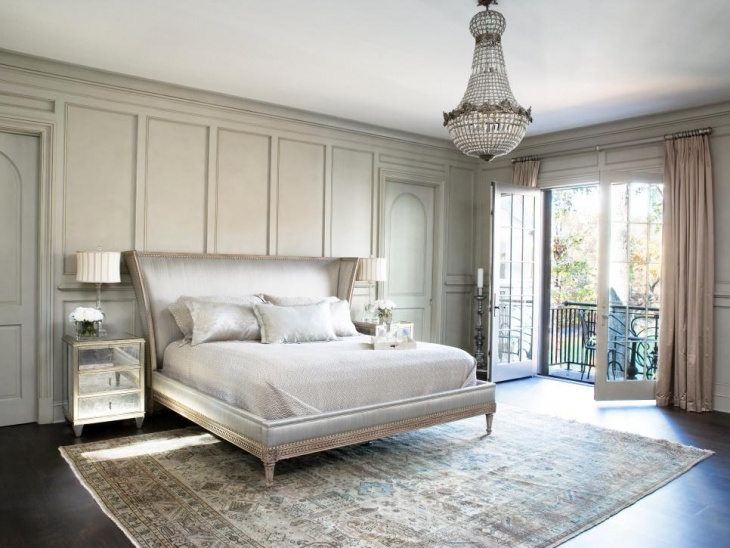 neutral bedroom with vintage chandelier