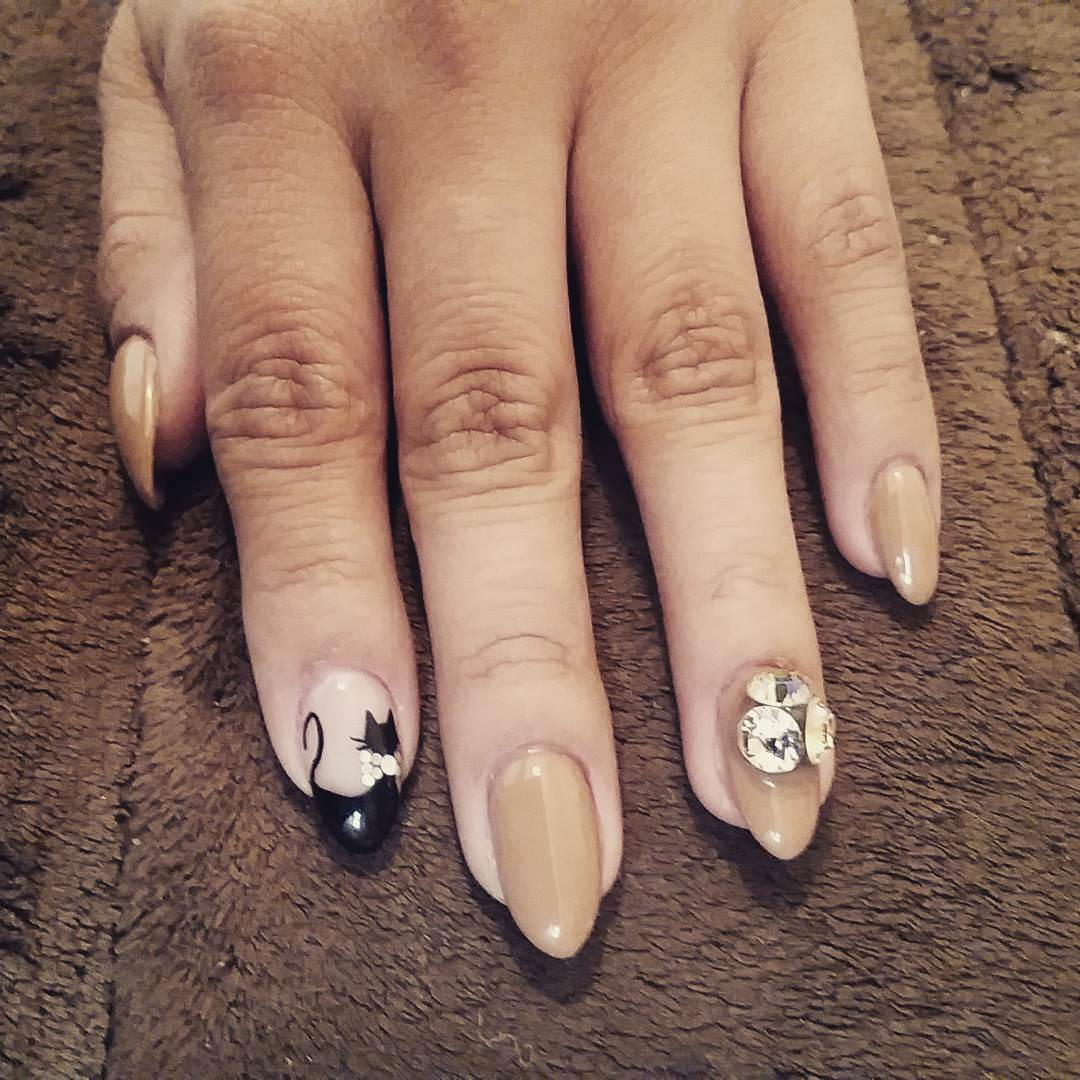 Tan Animal Nail Design