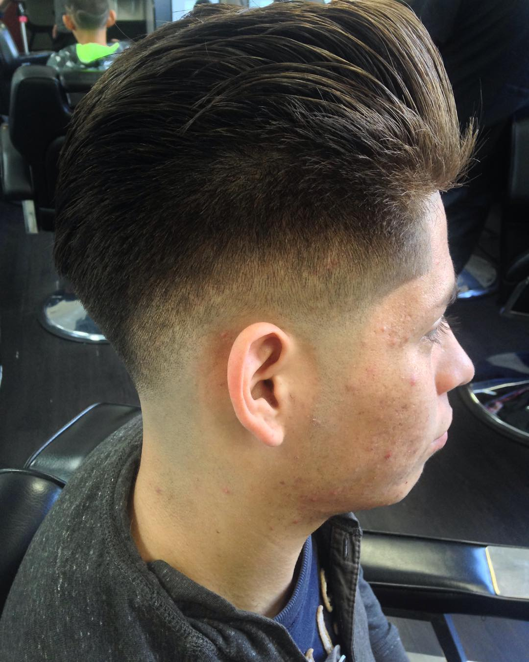 faded pompadour hairstyle