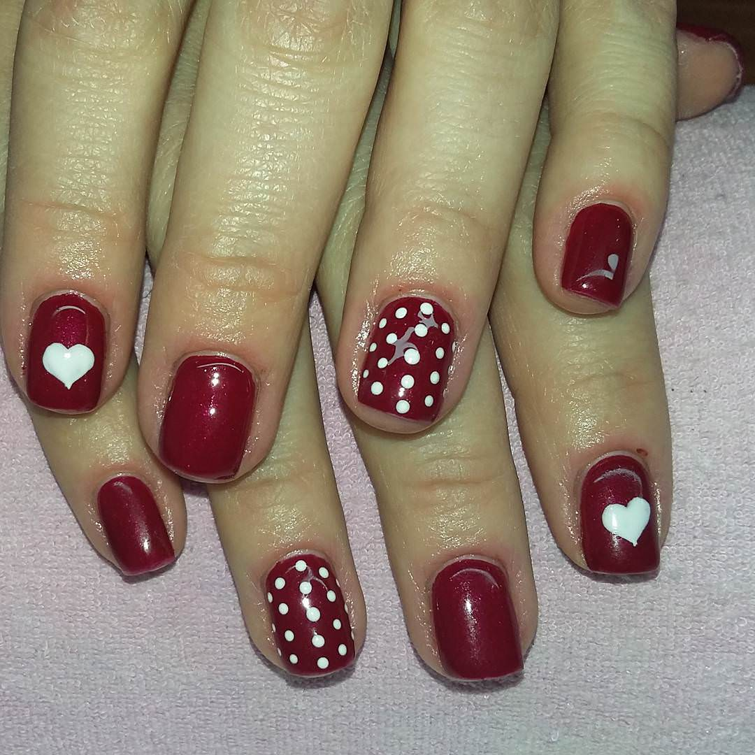 White Love Symbol Design On Red Nail Art