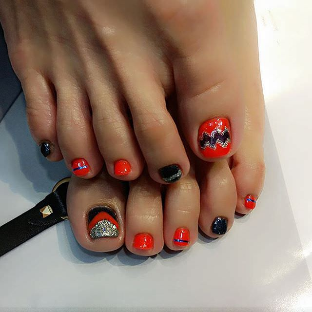 Orange Toes Nail Design