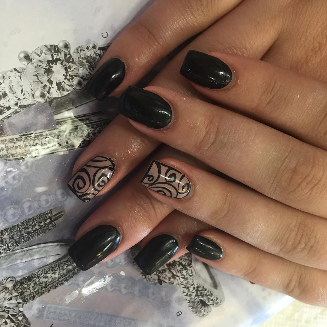 black swirling nail design