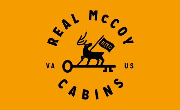 Real Mccoy Cabins Awesome Logo