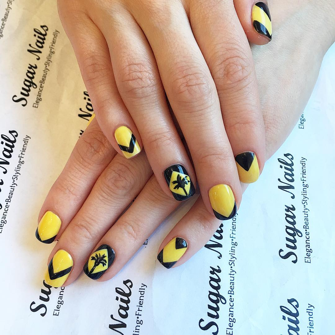 yellow and black nail art design