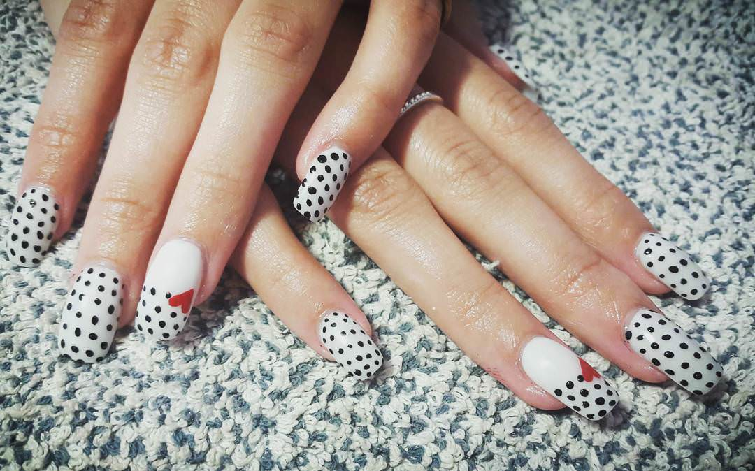 white acrylic nails with polka dots
