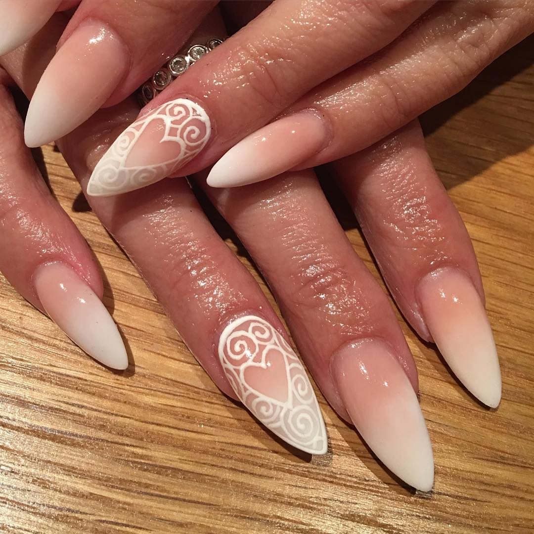 25 white acrylic nail art designs ideas design trends white heart shaped swirling nail design prinsesfo Choice Image