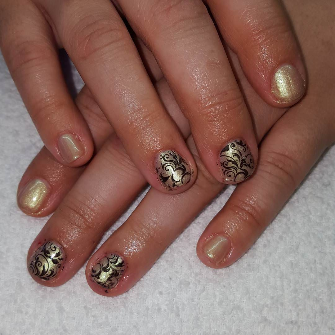 black and gold finger nail design