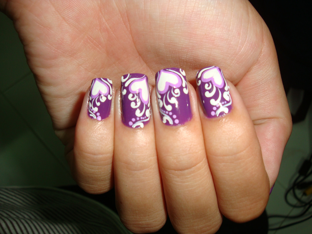 swirling heart shaped nail design