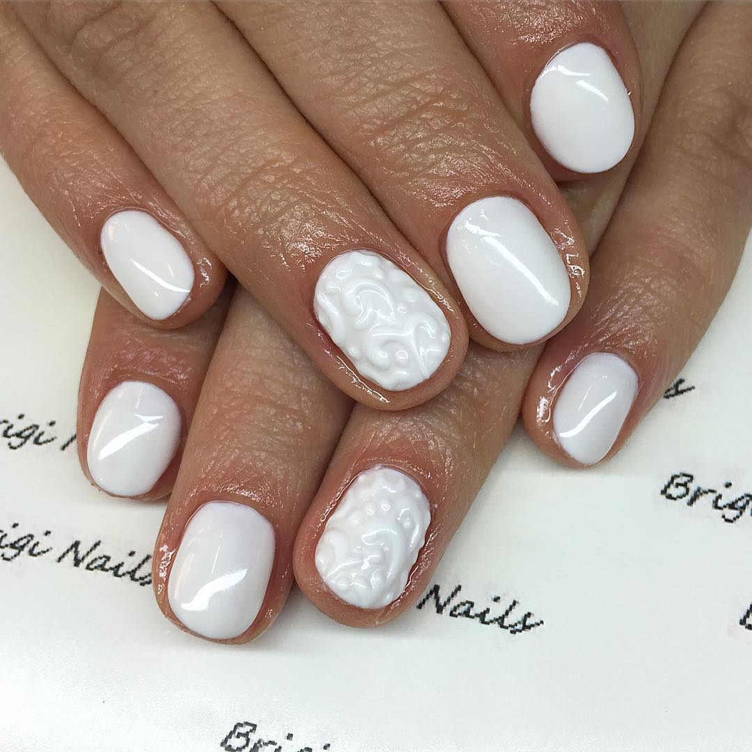 all white acrylic designed nail