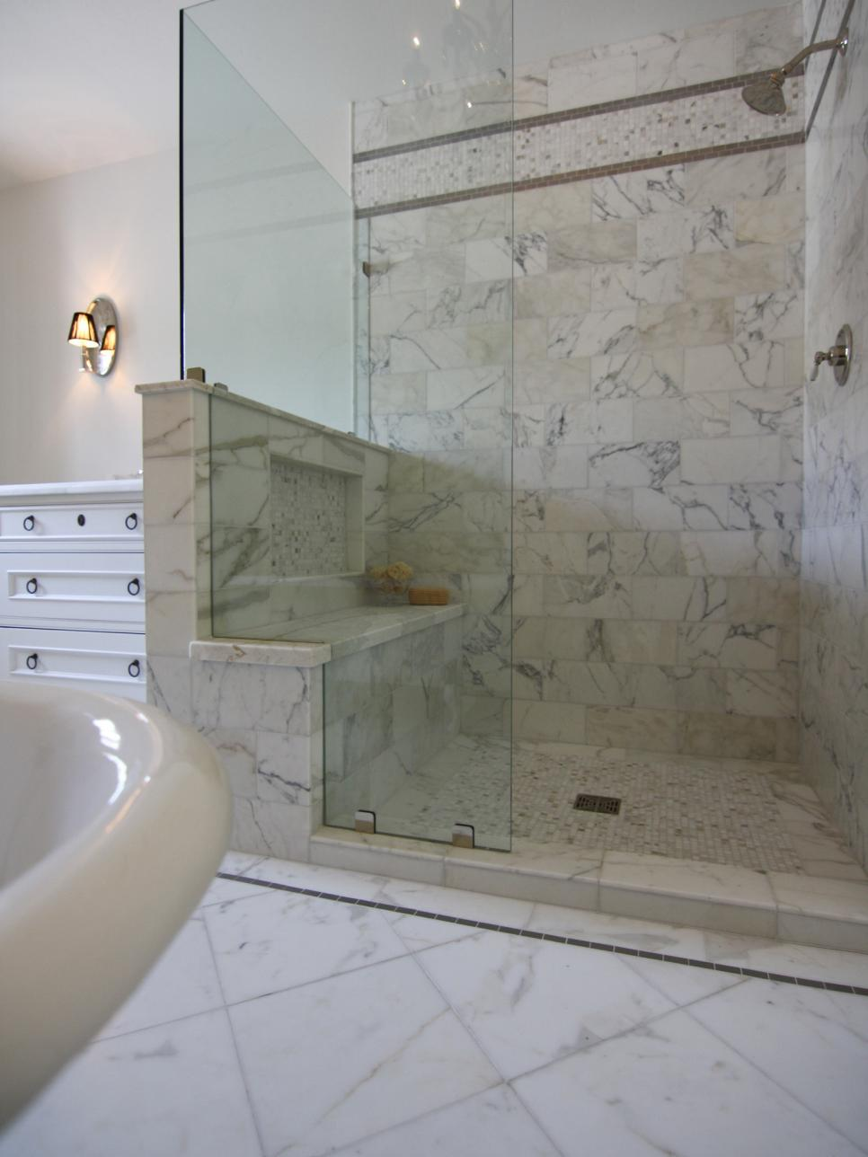 glassy shower with marble flooring and tiles