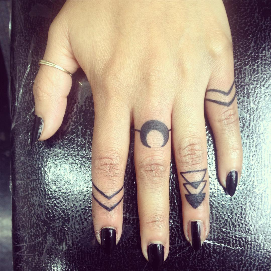 half moon finger ring tattoo