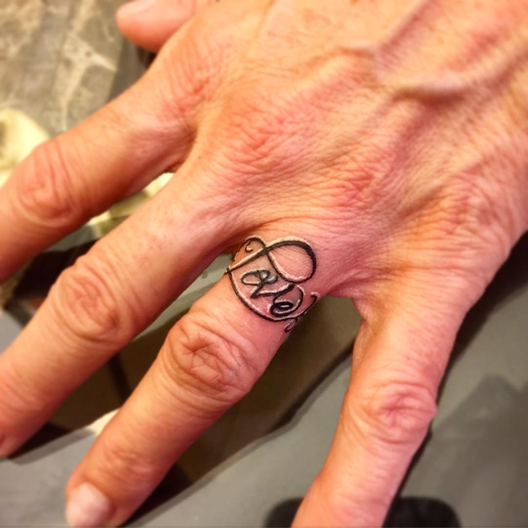 lettering ring tattoo art