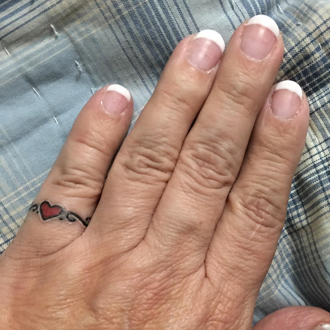 heart shaped little finger tattoo