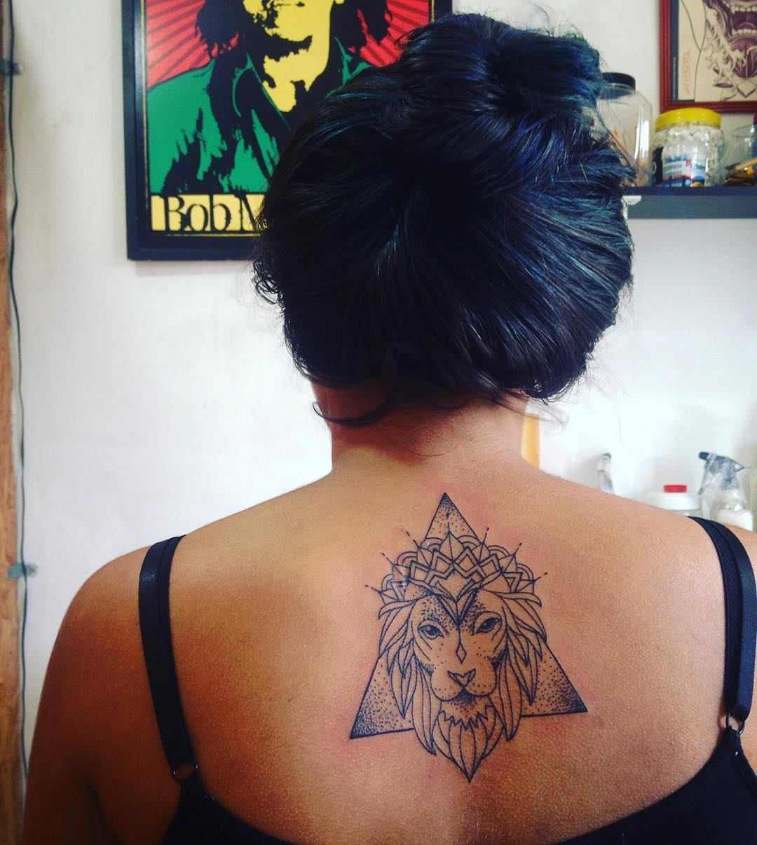 Lion Tattoo on Below Back Neck